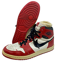 BNPS.co.uk (01202) 558833<br /> Pic: GreyFlannelAuctions/BNPS<br /> <br /> Pictured: The signed Michael Jordan's trainers.<br /> <br /> A pair of Michael Jordan's trainers from his debut basketball season have sold for over £300,000.<br /> <br /> The basketball legend wore the red and white Nike Air Jordan 1 shoes during the 1984-85 season while playing for the Chicago Bulls.<br /> <br /> He gave his size 13.5 footwear to veteran photographer Robert Crawford after the Bulls played the Indiana Pacers in 1985.<br /> <br /> The popularity of Jordan trainers has been driven by last year's acclaimed documentary 'The Last Dance' charting his time at the Bulls.<br /> <br /> Mr Crawford, who has kept hold of the shoes for 36 years, offloaded them with Grey Flannel Auctions, of Scottsdale, Arizona, US.