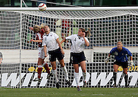 Leslie Osborne and Cat Whitehill go up for a header while goalie Hope Solo stands ready at the VRS Antonio Stadium in VRS Antonio, March 14, 2007, during the final of Algarve Women's Cup soccer match between USA and Denmark. USA won 2-0.