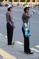 Yogyakarta, Java, Indonesia.  Women Traffic Police Officers, Jl. Laksda Adisucipto Street.