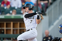 Adam Engel (7) of the Charlotte Knights follows through on his swing against the Durham Bulls at BB&T BallPark on May 15, 2017 in Charlotte, North Carolina. The Knights defeated the Bulls 6-4.  (Brian Westerholt/Four Seam Images)