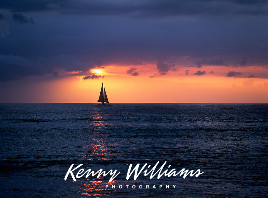 Sailboat Sailing into Sunset, Pacific Ocean, Hawaii, USA.