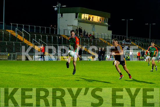 Cathal Moriarty, Mid Kerry in action against Cillian O'Regan, Dr. Crokes during the Kerry County Senior Football Championship Semi-Final match between Mid Kerry and Dr Crokes at Austin Stack Park in Tralee, Kerry.