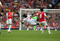 Pictured L-R: Nathan Dyer of Swansea is brought down by Mikel Arteta of Arsenal. Saturday 10 September 2011<br />