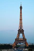 Eiffel Tower and city buildings at dusk, Paris, France.