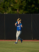 Jesuit Tigers outfielder Wes Mendes (11) catches a fly ball during a game against the IMG Academy Ascenders on April 21, 2021 at IMG Academy in Bradenton, Florida.  (Mike Janes/Four Seam Images)