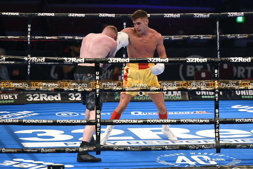 Levi Frankham (yellow shorts) defeats Dale Arrowsmith during a Boxing Show at the Royal Albert Hall on 10th July 2021