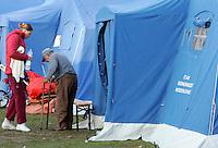 Una donna assiste un anziano nella tendopoli allestita per accogliere gli sfollati, in piazza d'Armi, all'Aquila, in Abruzzo, 8  aprile 2009, dopo il terremoto che ha colpito la regione..A woman gives assistance to an elderly man in a tent-camp set up by the civil protection agency, in L'Aquila, central Italy, 8 april 2009, to put up survivors of the earthquake that hit the region Abruzzo..UPDATE IMAGES PRESS/Riccardo De Luca