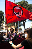 Rome, Italy. 25th Apr, 2021. Today, to mark the 76th Anniversary of the Italian Liberation from nazi-fascism (Liberazione), Azione Antifascista Roma Est, supported by ANPI Centocelle (National Association of Italian WWII Partizans), and various Antifascist organizations, movements, students, political parties, social centres, held a march (Corteo) from Piazza delle Camelie to Villa Gordiani's Park (1.), in Centocelle's district. The demonstration began with a rally in front of the Memorial dedicated to the Partizans of Centocelle victims of nazi-fascist occupation troops and retaliations, where Partizans and their relatives, activists, historians gave speeches to remember the population struggle and solidarity, to keep the memory and the lesson of the Resistenza alive and to reaffirm the values of Freedom and Justice of the Italian Antifascist Constitution as the only way to fight against fascist pulsions re-appearing all over the world.  <br /> On the 4th June 2018 the Centocelle's District was awarded of the State Gold Medal (for Civil Merit) for its Antifascist Resistance (2.).<br /> <br /> Footnotes & Links: <br /> 1. http://bit.do/fQB69 <br /> 2. http://bit.do/fQB7m <br /> Previous 25 Aprile's Events:<br /> - 25 Aprile 2020: http://bit.do/fQB77 <br /> - I Partigiani http://tiny.cc/cwi3nz<br /> - 25 Aprile 2019 (at Ferramonti di Tarsia concentration camp) http://bit.do/fQB8i <br /> - 25 Aprile 2018 http://tiny.cc/dsi3nz<br /> http://www.anpi.it <br /> (Source, Wikipedia.org ENG) The Liberazione: https://en.wikipedia.org/wiki/Liberation_Day_(Italy)