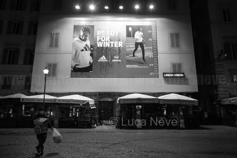 """Campo de' Fiori.<br /> <br /> Rome, 23/10/2020. Documenting the """"curfew"""" (coprifuoco) imposed from Friday night in Rome and its surrounding Lazio Region. The local authorities tightened rules and restrictions due to a spike in the Covid-19 / Coronavirus cases. 23 October bulletins sees 19.143 new cases, 91 people died, 182.032 tests made. Today, the President of Lazio Region, Nicola Zingaretti (Leader of the Democratic Party, PD, party member of the Italian Coalition Government), imposed the night curfew, from midnight to 5AM, for 30 days (1.). A new self-certification (autocertificazione, downloadable from here 1.) is needed to leave home which is allowed only for urgent reasons, mainly work and health. Furthermore, the Mayor of Rome, Virginia Raggi, implemented """"no-go zones"""" restrictions from 9PM in some of the areas and squares of the Eternal City famous for the nightlife, including Campo de' Fiori, Via del Pigneto, Piazza Trilussa in Trastevere district and Piazza Madonna de' Monti.<br /> <br /> Footnotes & Links:<br /> 1. http://www.regione.lazio.it/binary/rl_main/tbl_news/ordinanza_regione_lazio_intesa_Ministro_salute__mod_accettate_rev1__ore_24_1_signed.pdf<br /> <br /> March 2020, Coronavirus lockdown in Rome:<br /> - 12.03.2020 - Rome's Lockdown for the Outbreak of the Coronavirus In Italy - SARS-CoV-2 - COVID-19: https://lucaneve.photoshelter.com/gallery/12-03-2020-Romes-Lockdown-for-the-Outbreak-of-the-Coronavirus-In-Italy-SARS-CoV-2-COVID-19/G0000jGtenBegsts/<br /> - 07-23.03.2020 - Villaggio Olimpico Ai Tempi del COVID-19 - Rome's Olympic Village Under Lockdown: https://lucaneve.photoshelter.com/gallery/07-23-03-2020-Villaggio-Olimpico-Ai-Tempi-del-COVID-19-Romes-Olympic-Village-Under-Lockdown/G0000D2L9l0ibXZI/"""