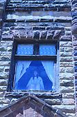 Indian Maiden Statue in Window