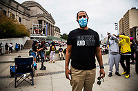 NEW YORK, NY - OCTOBER 24: A man wears a voting support shirt next to the Brooklyn Museum during early voting for the United States Presidential election on October 24, 2020 in New York City. Due to concerns about the coronavirus and social distancing, New York State is allowing early voting for the first time to protect voters from new infections in the city (Photo by Pablo Monsalve / VIEWpress via Getty Images)