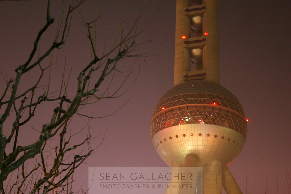 CHINA. Shanghai. A view of the Oriental Pearl Tower. The Oriental Pearl Tower stands by the bank of Huangpu River. It is in the centre of Lujiazui, opposite to the Bund which is famous for its grand buildings of various architectural styles. The tower is 468 metres high. It is the highest TV Tower in Asia and is the third highest one in the world. 2008..