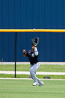 FCL Yankees outfielder Jasson Dominguez (25) catches a fly ball during a game against the FCL Tigers on June 28, 2021 at Tigertown in Lakeland, Florida.  (Mike Janes/Four Seam Images)