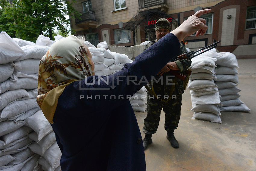 A local citizen having conversation with pro-russian activists at one of the check points on the streets of Slavyansk