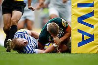 Photo: Richard Lane/Richard Lane Photography. London Irish v Saracens. London Double Header. Aviva Premiership. 07/09/2013. Irish's Kieran Low touches down for a try as Saracen's Rhys Gill tackles.