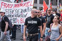 """Neonazis und Hooligans demonstrieren gegen Angela Merkel.<br /> Unter dem Motto """"Merkel muss weg"""" zogen ca. 1.200 am Samstag den 30. Juli 2016 mit einer Demonstration durch Berlin. Der Aufmarsch war vom einschlaegig bekannten Neonazi-Hooligan Enrico Stubbe angemeldet worden.<br /> Die Polizei hatte die Aufmarschroute der Rechten weitraeumig abgesperrt.<br /> Die Rechten forderten in Sprechchoeren immer wieder """"Nationalen Sozialismus! Jetzt!"""" (ein strafrechtlicher Trick, gemeint ist der Nationalsozialismus), beschimpften waehrend ihres Aufmarsches permanent Gegendemonstranten """"Wir kriegen euch alle"""" und """"Hurensoehne"""" und die Medienvertreter """"Luegenpresse"""". Mitarbeiter der Sicherheitsbehoerden erklaerten, dass es eindeutig ein rechtsextremer Aufmarsch gewesen sei bei dem sich keinerlei buergerliche Teilnehmer beteiligt haetten. Der Berliner Chef des Landesamt fuer Verfassungsschutz war persoenlich vor Ort um sich einen Eindruck zu verschaffen.<br /> Im Bild: Ein Demonstrationsteilnehmer traegt ein T-Shirt mit der Aufschrift """"Weisse Woelfe"""" und einem Totenkopf.<br /> 30.7.2016, Berlin<br /> Copyright: Christian-Ditsch.de<br /> [Inhaltsveraendernde Manipulation des Fotos nur nach ausdruecklicher Genehmigung des Fotografen. Vereinbarungen ueber Abtretung von Persoenlichkeitsrechten/Model Release der abgebildeten Person/Personen liegen nicht vor. NO MODEL RELEASE! Nur fuer Redaktionelle Zwecke. Don't publish without copyright Christian-Ditsch.de, Veroeffentlichung nur mit Fotografennennung, sowie gegen Honorar, MwSt. und Beleg. Konto: I N G - D i B a, IBAN DE58500105175400192269, BIC INGDDEFFXXX, Kontakt: post@christian-ditsch.de<br /> Bei der Bearbeitung der Dateiinformationen darf die Urheberkennzeichnung in den EXIF- und  IPTC-Daten nicht entfernt werden, diese sind in digitalen Medien nach §95c UrhG rechtlich geschuetzt. Der Urhebervermerk wird gemaess §13 UrhG verlangt.]"""