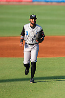Rocket City Trash Pandas right fielder Izzy Wilson (9) jogs toward the dugout during the game against the Tennessee Smokies at Smokies Stadium on June 12, 2021, in Kodak, Tennessee. (Danny Parker/Four Seam Images)