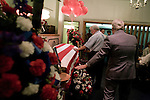 August 25, 2007. Kinston, NC.. A viewing of the coffin of Spc. Steven R. Jewell was held at Howard and Carter Funeral Home i Kinston, NC. Spc. Steven R. Jewell was killed in a helicopter crash  near the Iraqi city of Fallujah on August 14, 2007.. Jack Wisener, Spc. Jewell's stepfather, center, lays a hand on the coffin of his stepson.. .. .