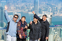 Tourists take a photo on the observation viewpoint with Hong Kong panorama behind