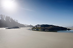 Pacific Rim National Park Reserve, Long Beach, surreal morning scenery of the sandy ocean shore during low tide in bright summer sunshine. Tofino, Vancouver Island, BC, Canada. Image © MaximImages, License at https://www.maximimages.com