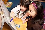 Education Preschool Headstart two girls using marker on dry erase board