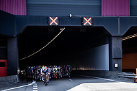 peloton rolling out of a tunnel <br /> <br /> Antwerp Port Epic 2020 <br /> One Day Race: Antwerp to Antwerp 183km; of which 28km are cobbles and 35km is gravel/off-road<br /> Bingoal Cycling Cup 2020