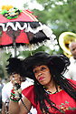 Members of the Baby Doll Sisterhood second line in memory of Baby Doll Tee Eva Perry, who died at 83 on June 7, in New Orleans, La. Monday, June 11, 2018. Cinnamon Black