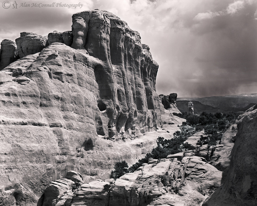 """""""Wall and Pillar""""<br /> Arches National Park, Utah<br />  2014<br /> <br /> Besides the well-known structures from it's namesake, Arches National Park also have some magnificent sandstone walls and pillars.  The illumination from the filtered sun enhances the details of the wall while it awaits the incoming spring storm.  <br /> <br /> 4 x 5 Large Format Film"""