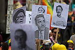 © Joel Goodman - 07973 332324 . 27/08/2016 . Manchester , UK . Placards featuring gay heroes . Annual Pride Parade through Manchester City Centre as part of Manchester Gay Pride's Big Weekend . Photo credit : Joel Goodman