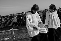 Young Czech monks read bible during the open-air mass served by the Pope Benedict XVI in Stara Boleslav, one of the main pilgrimage site of the Czech Republic, September 28, 2009.