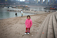 CHINA. Sichuan Province. Chongqing. A young girl on the banks of The Yangtze River which is at its lowest level in 150 years as a result of a country-wide drought. Chongqing is a city of over 3,000,000 people, famed for being the capital of China between 1938 and 1946 during World War II. It is situated on the banks of the Yangtze river, China's longest river and the third longest in the world. Originating in Tibet, the river flows for 3,964 miles (6,380km) through central China into the East China Sea at Shanghai.  2008.