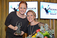 """December 08, 2014, Amsterdam, Amstel Hotel, Tennis player off the Year Awards, Aniek van Koot receives the wheelchair tennis player off the year award, the """"Esther Vergeer"""" trophy out of the hands of Ester Vergeer.<br /> Photo: Henk Koster"""