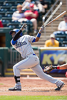 Angelys Nina #3 of the Tulsa Drillers follows through his swing during a game against the Springfield Cardinals at Hammons Field on May 7, 2013 in Springfield, Missouri. (David Welker/Four Seam Images)