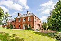 BNPS.co.uk (01202) 558833. <br /> Pic: Strutt&Parker/BNPS<br /> <br /> Pictured: Combe Florey House. <br /> <br /> A grand Georgian manor where writer Evelyn Waugh lived and died is on the market for £5.5m.<br /> <br /> The author of Vile Bodies, Brideshead Revisited and Sword of Honour bought Combe Florey House in Somerset in 1956 and his family lived there until 2008 when they sold it to the current owners.<br /> <br /> In Waugh's day the house was often filled with his glamorous and clever guests like poet John Betjeman, actors Peter Cook and Alec Guinness and writers Salman Rushdie and Muriel Spark.<br /> <br /> The 12-bedroom house has had a makeover since Waugh's day and quirky style and is now a light-filled spacious family home with a party barn, swimming pool and 34 acres.