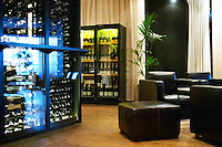 Bar lounging chairs and wine storage refrigerator cupboards. Vassa Eggen gastronomic restaurant. Stockholm. Sweden, Europe.