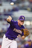 LSU Tigers pitcher Ryan Eades #37 makes a pickoff throw to first base against the Auburn Tigers in the NCAA baseball game on March 23, 2013 at Alex Box Stadium in Baton Rouge, Louisiana. LSU defeated Auburn 5-1. (Andrew Woolley/Four Seam Images).