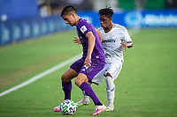 LAKE BUENA VISTA, FL - JULY 31: Joao Moutinho #4 of Orlando City SC battles for the ball during a game between Orlando City SC and Los Angeles FC at ESPN Wide World of Sports on July 31, 2020 in Lake Buena Vista, Florida.