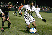 Justin Morrow #21 of Notre Dame controls the ball in front of Sebastian Harris #4 of Oakland. The University of Notre Dame defeated Oakland University 2-1 in the second round of the NCAA championship at Alumni Field at the University of Notre Dame in South Bend, Indiana on November 28, 2007.