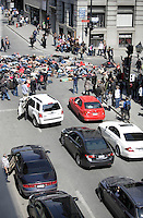Montreal (QC) CANADA - April 17, 2012 - Students on strike block the corner of Notre-Dame and Saint-Laurent streets for a few minutes.
