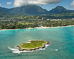 The jewel tones of Flat Island and the waters off Kailua beach contrast with the lush greenery of the Koolau Mountains and Windward Oahu.