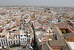 View from La Giralda over the roof tops towards Puente del Alamillo in Seville, Spain.