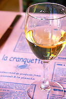 Gruissan village. La Clape. Languedoc. Restaurant La Cranquette. France. Europe. Wine glass.