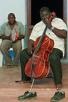 Zanzibar, Tanzania.  Taarab Musicians.  Culture Musical Club.  Cello Player.