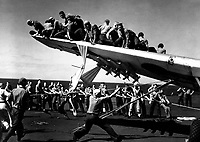 Crash of TBM #11, VC-69, in port catwalk of USS BOGUE.  #11 being raised from catwalk.  June 1944.  L.F. Cirzan.  (Navy)<br /> Exact Date Shot Unknown<br /> NARA FILE #:  080-G-266523<br /> WAR & CONFLICT BOOK #:  965