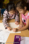 Elementary School New York Grade 2 science  social studies two girls working together on project vertical