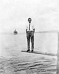 Lakewood NY:  Clark Stewart waiting for the City of Cleveland Ferry. Photographs were taken during a church field trip to Chautauqua Institution in New York (Lake Chautauqua). The Stewart family and friends visited Chautauqua during 1901 to hear Stewart's relative, Dr. S.H. Clark speak at the institute. Alice Brady Stewart chaperoned and Brady Stewart came along to photograph the trip.  The Gallery provides a glimpse of how the privileged and church faithful spent summers at Lake Chautauqua at the turn of the century.