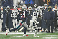 FOXBOROUGH, MA - NOVEMBER 24: Dallas Cowboys Wide Receiver Amari Cooper #19 runs after a short pass with New England Patriots Cornerback Stephon Gilmore #24 closing in during a game between Dallas Cowboys and New England Patriots at Gillettes on November 24, 2019 in Foxborough, Massachusetts.