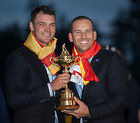 28.09.2014. Gleneagles, Auchterarder, Perthshire, Scotland. The Ryder Cup, final day.  Martin Kaymer and Sergio Garcia (EUR) celebrate with the Ryder Cup after Sunday Singles.  Europe won sixteen and a half points to eleven and a half points.