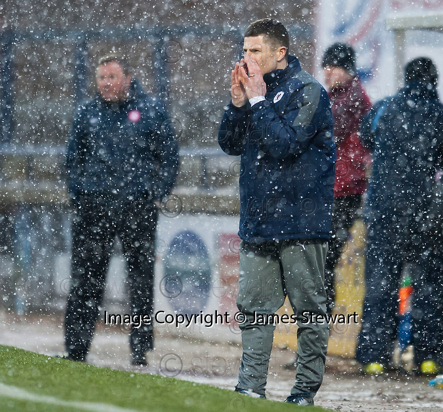Raith Rovers' manager Grant Murray tries to communicate through the snow.