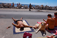 family sunbathing with their dog. Piran , Slovenia